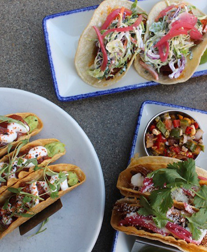 Array of three plates of various taco presentations